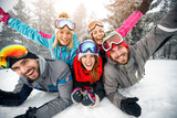 Group of skiers enjoying together on snow in mountain