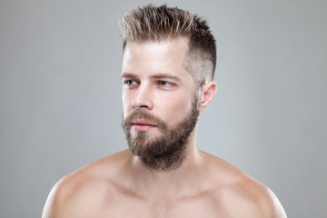 Portrait of young bearded man with a new hair cut © and.one