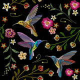 Beautiful hummingbirds and exotic flowers embroidery on black background. Template for clothes, textiles, t-shirt design. Humming bird and tropical flowers embroidery seamless pattern - 182154020