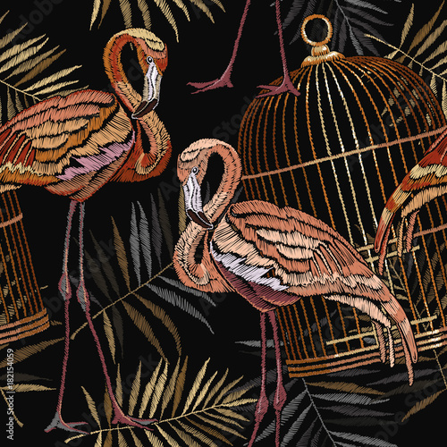 Embroidery flamingo , palm tree and birds cage tropical seamless pattern. Fashionable template for design of clothes. Embroidery pink flamingos, tropical summer fashion background - 182154059