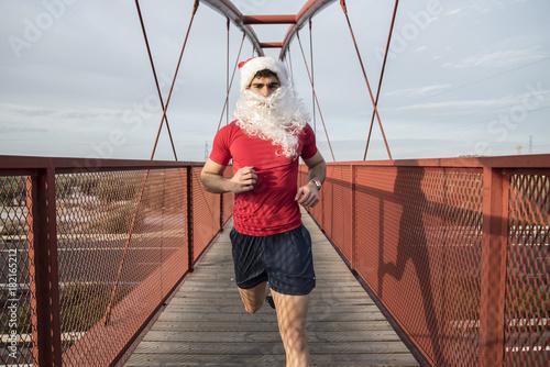 Plexiglas Fitness Santa Claus running on bridge for burn fat after christmas holidays