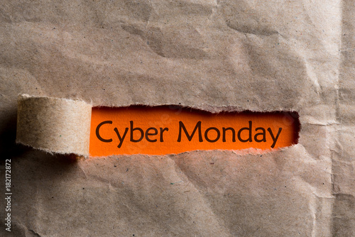 Cyber Monday - message appearing behind ripped brown paper. Best online shopping time. Day with biggest Sale. Mockup