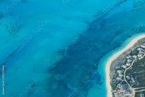 Fotobehang Blauw View of Turquoise Sea and Sandy Beach from an Airplane