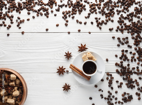 Fototapeta cup of coffee on white table