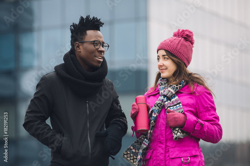 Multiracial students friends walking and talking in winter Poster