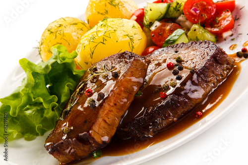Fotobehang Steakhouse Grilled steak with vegetables on white background