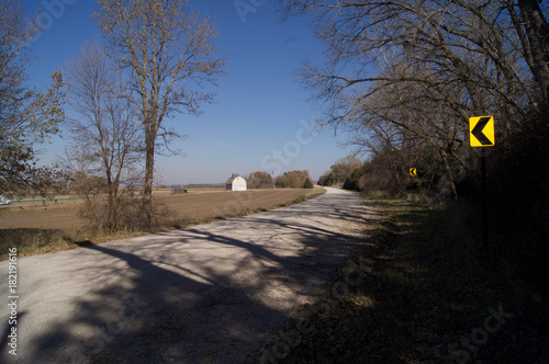 Foto op Canvas Cappuccino Gravel Road and Barn