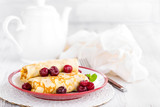 Sweet pancakes with cherry - 182193084
