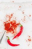 Raw fresh organic and dried ground chili pepper on white marble background top view copy space - 182195489