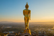 The iconic standing Buddha on Wat Phra That Khao Noi one of the most tourist attraction places in Nan province of northern Thailand during the sunrise.