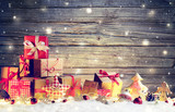 Rustic Gift Boxes On Snow With Christmas Ornament And Wooden Background  - 182197872