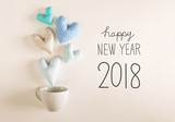 New Year 2018 message with blue heart cushions coming out of a coffee cup - 182210413