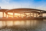 Round highway intersection water front, transportation background - 182222427