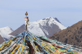 Tibetan landscape in China with prayer flags on foreground and mountains on background - 182225440