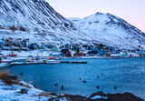 Siglufjordur harbor  at dawn in winter. Siglufjordur a small fishing town in a narrow fjord on the northern coast of Iceland. - 182227274