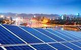 Photovoltaic and city skyline