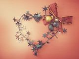 Heart shape Christmas decoration with bowtie and shiny balls. pink gradient background. - 182233472