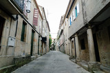 Empty street in town's historic quarter Pontevedra (Spain). Masonry walls and stone columns. Horizontal - 182239410