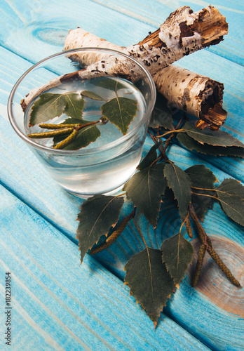 Poster Sap A glass of birch juice on wooden background