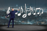 Businessman in front of a wall with 3d render music notes - 182243648