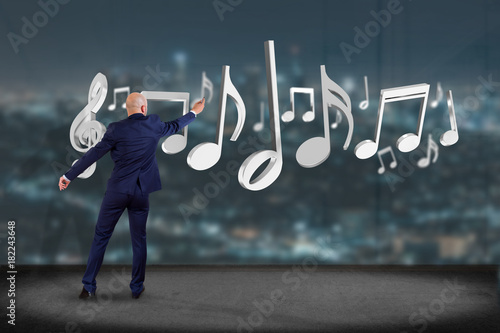 Plexiglas Muziek Businessman in front of a wall with 3d render music notes