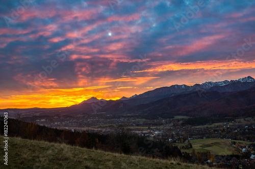Dawn over peak Havran and Zakopane in Tatra mountains from Koscielisko, Poland
