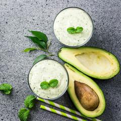 Avocado spinach smoothie. Top view, copy space.