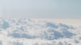 aerial shot from plane flying above the clouds in daytime - 182268023