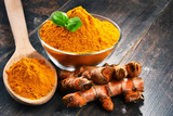 Composition with bowl of turmeric powder on wooden table - 182273881