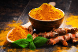 Composition with bowl of turmeric powder on wooden table - 182274289