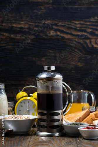 freshly brewed coffee and an assortment of breakfast foods, vertical