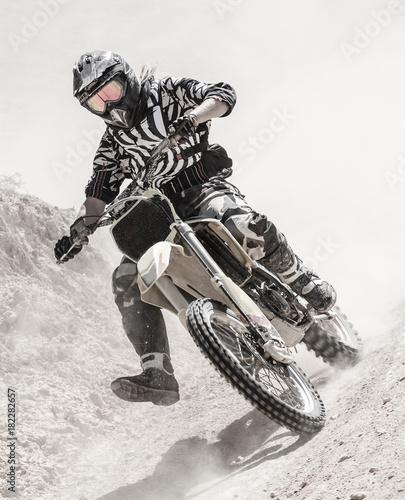 motocross rider on a dusty road
