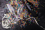 Party with champagne, glasses and confetti. New Year's Eve or birthday - 182288220
