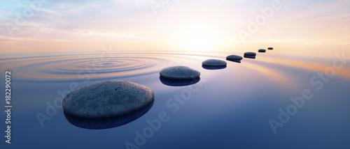 Leinwanddruck Bild Steine im See bei Sonnenuntergang