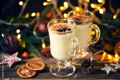 Poster Eggnog in glasses with cinamon and star anise on wooden table