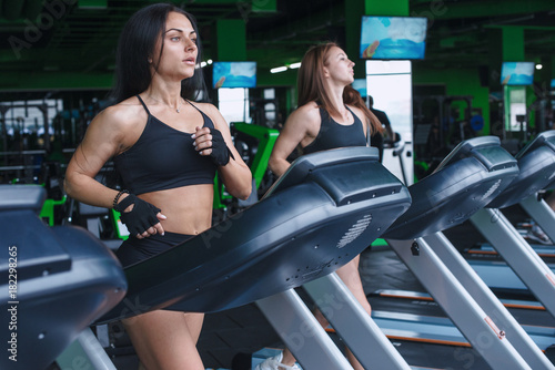 Póster two woman run treadmill in gym