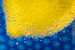 Lemon in bubbles on blue background. Macro shot. - 182300679