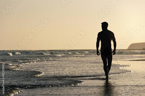 Naked men in the beach of Fuerteventura, Spain.