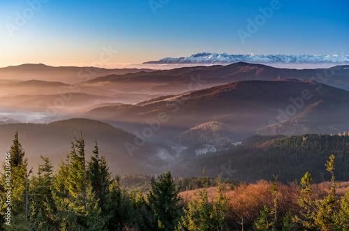 Plexiglas Zwart panorama over misty Gorce to snowy Tatra mountains in the morning, Poland landscape