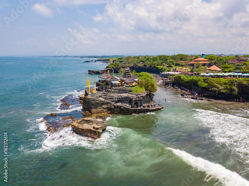 Foto op Canvas Blauwe jeans Aerial view of Tanah Lot hindu temple on water in Bali island, Indonesia.