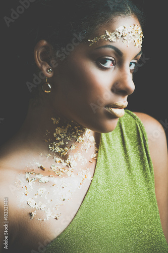 black beauty woman portrait with gold flakes