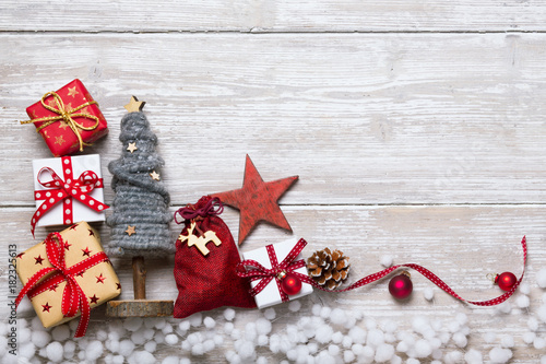 Christmas decoration on rustic wooden table  -  Flat lay, background