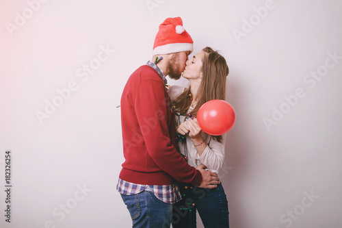 loving couple decorating Christmas tree Poster