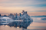Beautiful view of Niedzica Castle during a frosty evening, Poland - 182326830