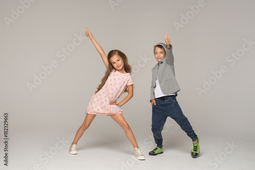 Fototapeta Happy dancing kids. Studio photo.