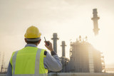 Manager Engineering in standard safety uniform working in gas turbine electric power plant  during sunset or morning time background - 182335889