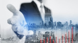 Double exposure Businessman extending hand with buildings in the city and raising graph - 182340456
