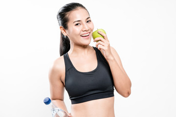 carefree healthy hispanic woman with apple and water smiling with cheerful confidence on white
