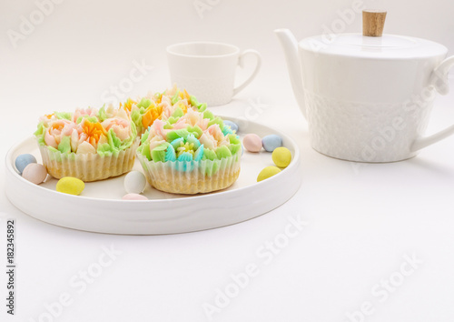 Top view decorated cupcakes with Easter eggs on white Background. Poster