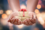 Human hands holding gift box for boxing day - 182356227